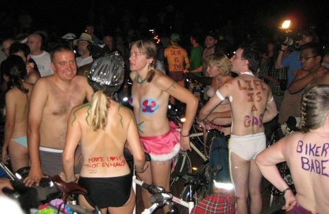 called Slogans Painted on Partially Naked People on Bikes Night,